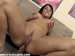 Beverly sucks on a thick brutal dildo before it slides into her tiight pussy. But she wants it into her asshole too and it leaves a big gaping hole like never before.