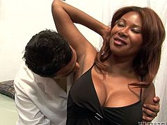 Curvy ebony milf Kymora Lee is having fun with a man called Hagi indoors. She sucks and rides his boner and Eric Jover keeps watching them all the time.