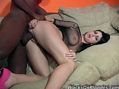 Sizzling brunette chick sucks big black cock with a smile on her face. Later on she gets fucked hard and deep on a sofa.