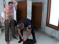 Tyler Saint gets undressed and tied up by Dean Tucker. Later on Tyler sucks big dick and gets his ass destroyed with a police baton.