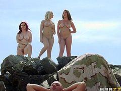 Mary Jane Mayhem, Brooke Wylde, and Chloe Addiso are outside in the desert and they are ready to share a huge cock for the very first time. Watch them switching turns to get drilled.