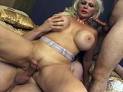Extreme double penetration is what this stunning milf with huge tits is here for! Babe is going to love it from both men!