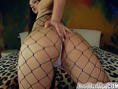 Yvette is a horny brunette having her asshole drilled by this guy's thick cock after she plays with herself while wearing full body fishnet lingerie.