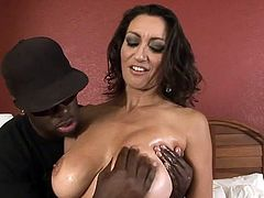 Huge tits milf receives a big black cock to slam hard into her juicy cunt