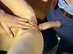 Light haired voluptuous hootchie lied leg spread and mouth opened on table. Her thirsting holes were attacked by two throbbing peckers from both sides simultaneously. Take a look at this dirty 3some office table poking in The Classic Porn sex video!