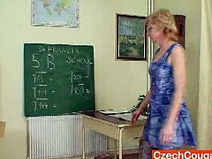 This mature schoolteacher was supposed to do some work, but she got bored. So, instead of doing school stuff, she did something better for herself. She fucked her cunt with a toy.