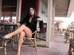 Witness this clip where a long haired brunette, with born gazongas wearing a black thong, touches herself in public. She really likes exposing herself!