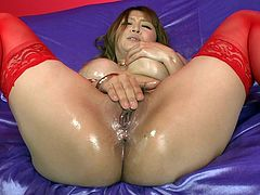 Leg spread sultry seductress Asian Sweetie with big boobs rubs her clit and hammers her thirsting