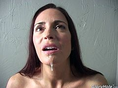 Sexy brunette milf Cheyenne Hunter is having a good time in hot gloryhole action. She sucks and rubs the black boner sticking out of the hole in the wall and gets her mouth filled with jizz soon.