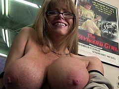 Masturbate watching this blonde cougar, with titanic gazongas wearing glasses, while she shows her boobs and talks about being a pornstar.