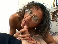 She wears glasses and that makes this dude horny even because she is a granny, this old slut has a lot of experience in cock sucking and jerking.