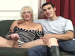 A guy gives a blowjob to blonde tranny. After that he takes pants off and takes big dick in his ass. Isla cums on guy's belly.