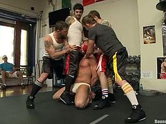 Morgan Black, Dayton O'Connor and other poofters are playing BDSM games in a gym. The gays bind and blindfold one of them, tie a dumbbell to his dick and then mouth-fuck him by turns.