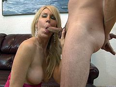 Sex addicted blonde MILF gets her hot tits licked. Then she gives an amazing blowjob to Mark Frenchy and gets banged on a sofa.