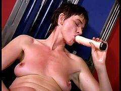Brunette woman takes clothes off and lies down on a bench. She fingers and then toys her shaved pussy with big dildo.
