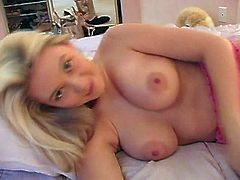 What are you waiting for? Watch this blonde princess, with natural bazookas wearing sexy lingerie, while she masturbates in her sweet bed.