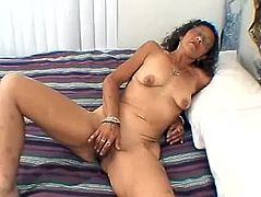 Brunette mature slut in glasses strips her clothes off and lies down on a bed. Candi fingers her old pussy until she cums.