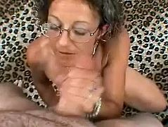 Get excited watching this mature woman, with natural boobs, while she pushes her hands up and down and by the help of her tongue this dude goes wild!