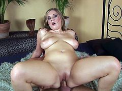 Her big boobs are bouncing like crazy while having her pussy slammed hard