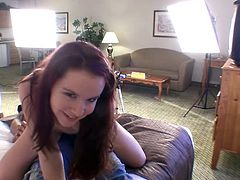 Playful redhead teen in panties sits down on the guy. She moves her nice mooty back and forth to give him pleasure.