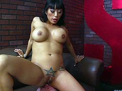 Busty beauty Gaia has a star tattooed above her clit. It's this guy's lucky star because he gets to sit underneath it. Gaia sits with her pussy on his face and enjoys a hot pussy licking until she wants to play some more. The brunette taunts and humiliates the guy, making him lick her high heels and feet