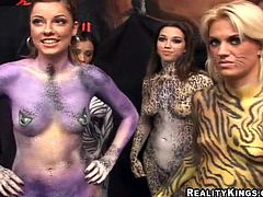 Check this amazing babes, with big boobs and their bodies painted like wild cats, get nailed hard doing a threesome in a funny clip.