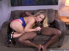 Take a look at this hardcore interracial scene where the sexy blonde Britney Young is nailed by this guy's large black cock.