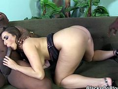 Paige Turnah is a sexy babe with big natural tits and an amazing ass. Watch this hottie getting out before taking this guy's monster black cock.