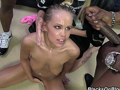 Watch the slutty Britney Young end up covered by warm cum in this hardcore scene where this slutty blonde is gangbanged by big black cocks.