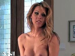 Cindy Hope dances around in her black and white lingerie. After taking her bra off, she gropes her tits.