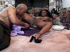 Super busty ebony has hairy pussy that needs to be shaved. She opens her legs for her man to shave that black snatch and to fuck her hard afterwards.