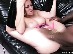 Redhead Ginger Blaze is on the way to orgasm in solo action