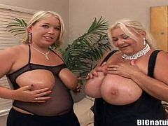 Entertain yourself watching these mature blonde ladies, with immense bazookas wearing black lingerie, while they play with each other's boobs.