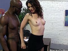 Watch the slutty brunette Sarah Shevon pumping this guy's big black cock to get it up before it penetrates her asshole.