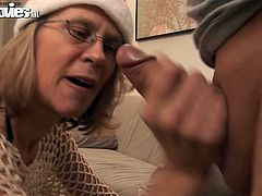 Take a look at this scene where the horny mature blonde Marga sucks on her man's cock before fucking him with a strapon.