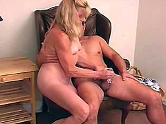 Blonde woman takes lingerie off and sits down near the guy. She gives an unforgetable handjob to lucky man.