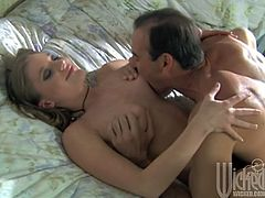 The guy can't wait to suck on her natural tits' hard nipples and her shaved pussy. Then he nails her in missionary position.