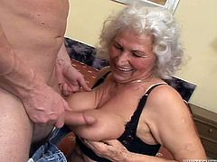 Lewd white-haired granny Marinoka is playing dirty games with some guy indoors. She gives a hot blowjob to the man and then they have sex in cowgirl, missionary and side-by-side positions.