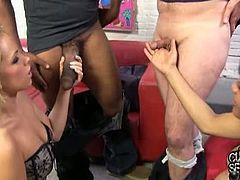 Britney Young has a boyfriend with a really small dick. She teams up with Lola Hart and suck on a black cock. The black dude fucks both their cunts and cums on Britney's titties.