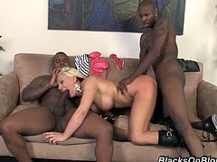 This sexy white girl with a shaved, pierced pussy gets her ass worked over by two hung black guys then she gets her face splattered with spunk.