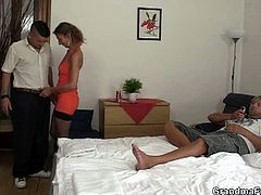 As if having a super sexy MILFish girlfriend wasn't enough! This couple checked into a hotel for some quality time together. Trying to come up with ways to spice up their sex life, they ended up deciding to have a threeway with the room service guy. Imagine his surprise when he showed up to answer their call and the slim, hot-looking old slut pulled out his dick and started sucking away! He didn't need to be talked into this, the lucky guy. Watch the two men give this insatiable granny a double pounding of her lifetime turning her mouth and pussy into sore engorged holes!
