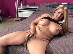 These two babes lick and tease their pussies then they get out the double ended dildo and share it as they fuck themselves.