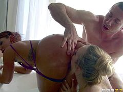 Aj Applegate and Savannah Fox shake their well shaped bare butts in front of lucky guy before it comes to ass licking. They tongue fuck each others anal holes like crazy in this scene.