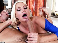 Blonde Nikita Von James with giant boobs has fire in her eyes while blowing mans hard love torpedo
