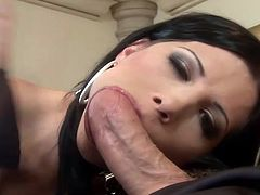 Amazing brunette chick in fishnets and high heels sucks huge dick with a smile on her pretty face. Then the guy starts to fuck in her in both holes.