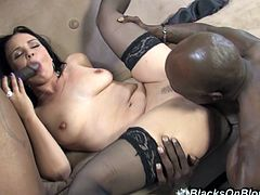 Prepare your cock for this long haired brunette, with a nice ass and natural tits wearing black stockings, while she rides like a horny cowgirl.