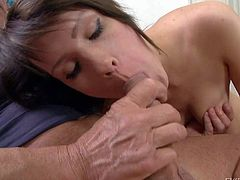 Totally naked sweet brunette Babette A with lovely natural tits opens her mouth wide before she gives head to mature guy. She sucks his rock solid experienced cock with big enthusiasm.