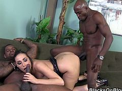 Beautiful girl with brown hair lifts a dress up to let one of the guys lick her pussy. Later on she gives them passionate blowjob. Paige takes two huge dicks in her soaking pussy.