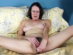 Veronica Snow is a hot cougar. She has big boobs and a bushy crotch. She uses a vibrator with which she applies pressure on her really pink clitoris to get off.