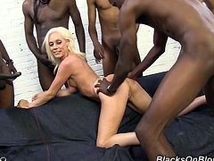 Make sure you have a look at this hardcore scene where the slutty Kacey Villainess is nailed by big black cocks in a gangbang.